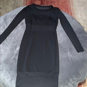 Women's long sleeve black dress, mesh midriff.